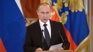 Russian President Vladimir Putin addressing military officials in Kremlin on Thursday.-AP